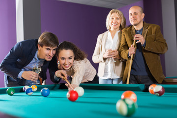 Laughing middle class people having pool game
