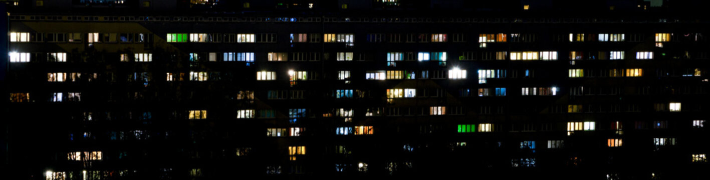 windows of apartment buildings at night, the light from the windows of houses, the evening landscape of the city, wallpaper, panorama