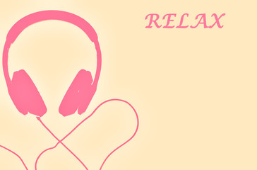 Pink headphones isolated on light yellow background. Word relax on the right side.