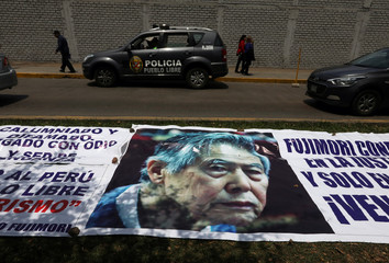 A banner with a picture of former President Alberto Fujimori is seen outside the Centenario hospital where he is hospitalised, after a judge annulled a presidential pardon and ordered his immediate capture and return to prison, in Lima