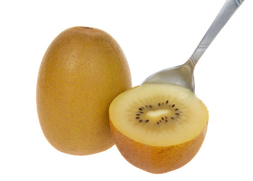 Sungold kiwi sliced in half with whole fruit behind, spoon slicing into the fruit, isolated. Unlike Green Kiwifruit, new SunGold Kiwifruit have a smooth skin and is less acidic than typical Kiwi fruit