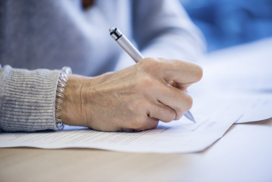 Close-up of businesswoman signing document