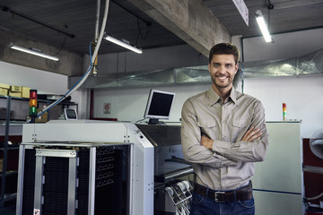 Portrait of engineer standing in office