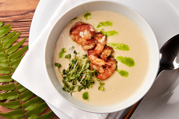 Creamy cheese soup with grilled shrimps