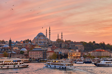 Bosphorus strait with ferry boats on the sunset in Istanbul