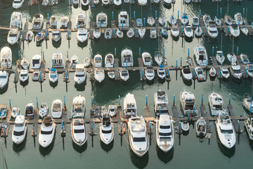 Yatch harbor marina pier and boat dock yatchs and vessels awaiting the open sea. Aerial drone view looking straight down above T-Head..