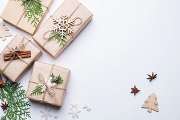 Christmas decor, gift boxes and spices on white background. Copy space