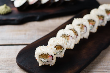 Japanese restaurant menu, professional culinary, delicious and beautiful food. Tasty appetizing sushi rolls with crab meat, close up