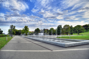 Colorful HDR image of the Multimedia Fountain Park in Warsaw, Poland on blue cloudy sky