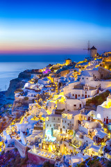 Travel Concepts. Skyline of Oia Town with Traditional White Architecture and Iconic Windmills in...