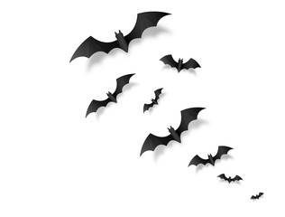 Black paper style vector flying halloween bats isolated on white background