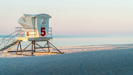 Empty Lifeguard Station on a beautiful tranquil white sand beach in Florida.