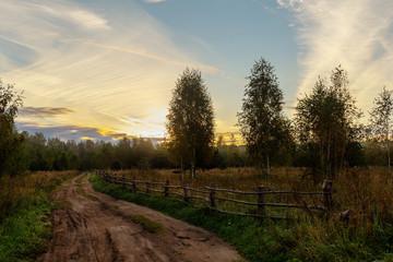 rural dirt road at sunrise