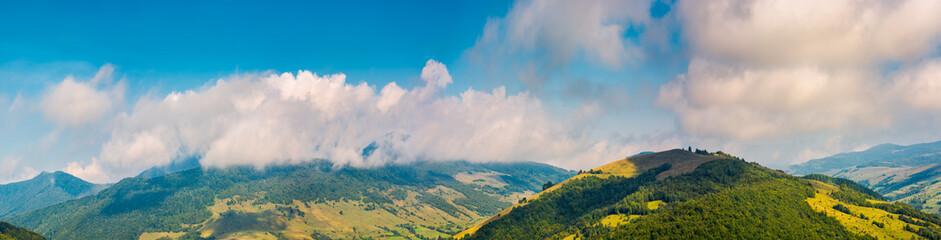 wonderful mountainous panorama in autumn. gorgeous cloudscape over the mountain