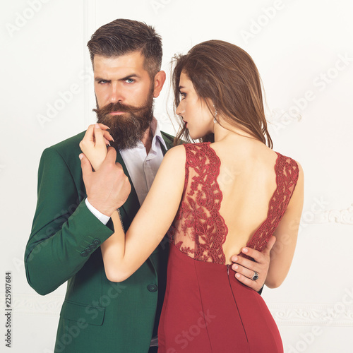 8066ac390d32 Attractive young sexual couple. Amazing pretty woman in red dress and man  wearing classical suit. Sexy passion couple in love. Portrait of beautiful  bearded ...