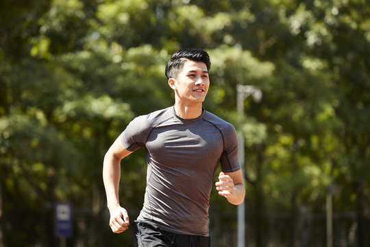 young asian male athlete running
