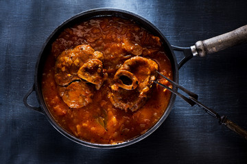Osso Buco Veal Shanks Prepared with tomatoes, carrots and onions in a cast-iron pan
