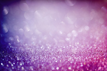Abstract colorful background with purple and blue glittering light bubbles