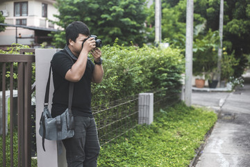 A man holding a camera things.