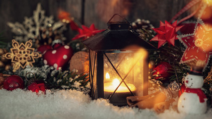 Nostalgic and romantic christmasdecoration with a little lantern and candle light