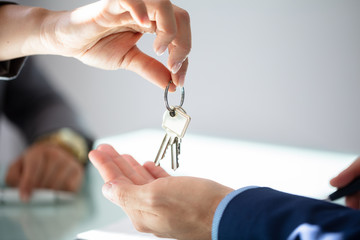 Estate Agent Giving House Key To Man