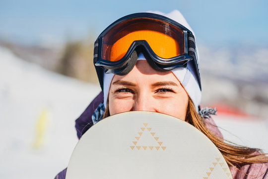 a young woman looks out of the snowboard