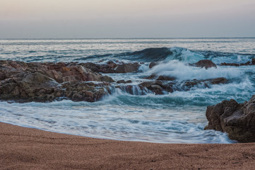 Foto op Plexiglas Kust View of the temperate Mediterranean Sea, wave, sea foam, rocky shores, Spain. image taken with long exposure