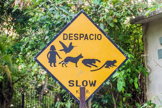Sign slow in Manuel Antonio village, Costa Rica