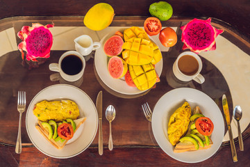 A delicious breakfast consisting of omelet, fruit and coffee
