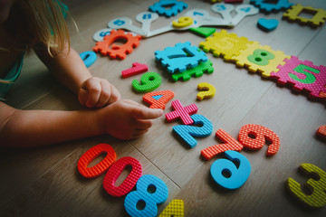little girl learning numbers and math, play with puzzle