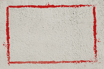 Thick red graffiti painted frame border on whitewashed concrete wall with copy space for writing