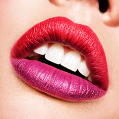 beautiful woman lips with  red and purple lipstick.
