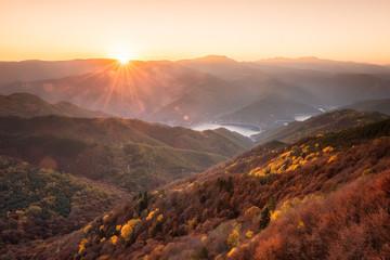 Autumn view from the top / Beautiful panoramic skyline autumn view with colorful sunrise above an autumn forest in Rhodope Mountains, Bulgaria.