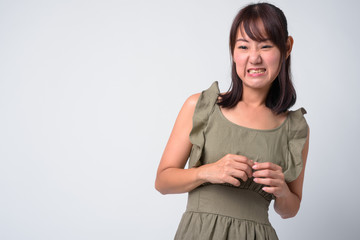 Portrait of beautiful Asian woman against white background