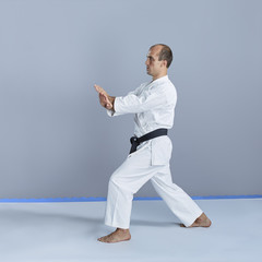 Young active athlete trains formal exercise karate