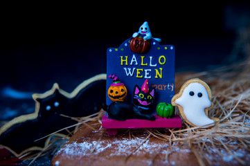 Fresh homemade decorated halloween cookies on dark background with copy space, top view
