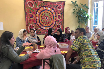 Amnesty International Secretary-General Kumi Naidoo speaks with refugee women during his visit to the shelter of the NGO Melissa Network in Athens