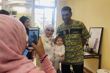 Amnesty International Secretary-General Kumi Naidoo poses for a picture with a refugee woman during his visit to the shelter of the NGO Melissa Network in Athens
