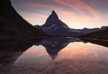 Fotomurales - The famous Matterhorn reflected in the Riffelsee and during a cool sunet in Switzerland.