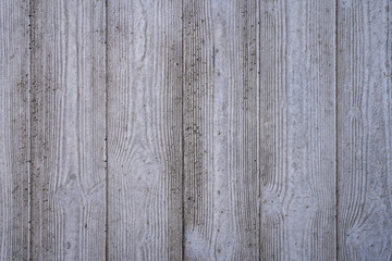 wood grain imprints in a concrete wall for backgrounds