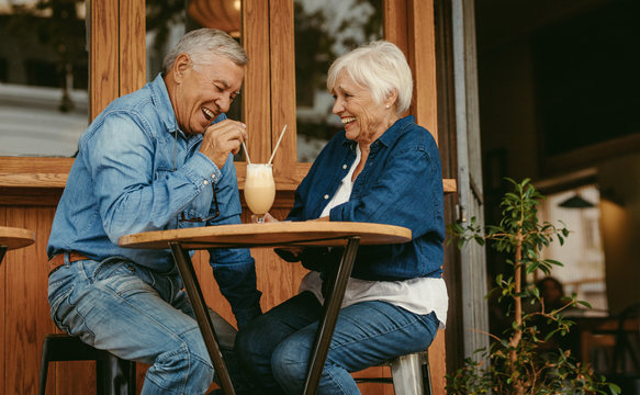 Senior couple having great time at cafe