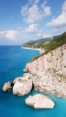 Aerial drone photo of iconic paradise beach of Kathisma with white rock steep cliff and emerald clear sea, Lefkada island, Ionian, Greece