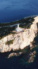 Aerial drone bird's eye view photo of iconic lighthouse in Cape Lefkada the Southest part of the island, Ionian, Greece
