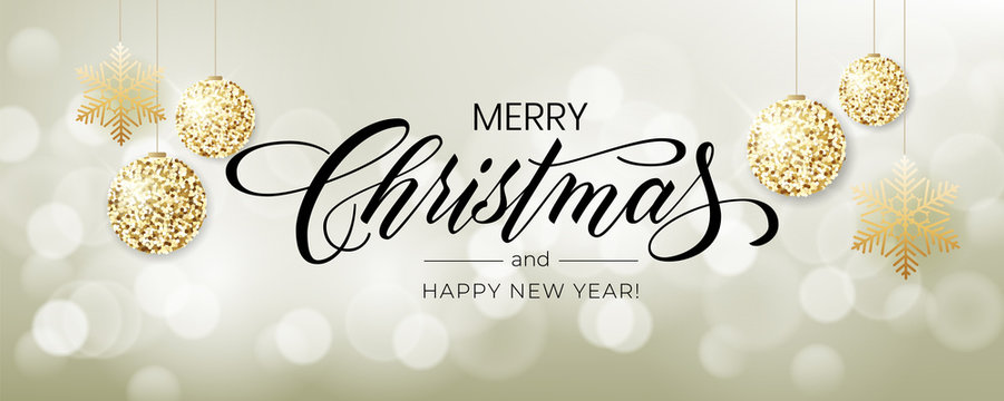 Merry Christmas background with blur bokeh light effect. Lettering Merry Christmas and Happy New Year