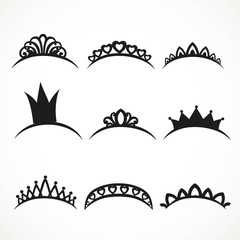 Set of black silhouettes of tiaras of various shapes on a white background