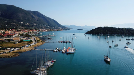 Aerial drone bird's eye view photo of iconic port of Nidri or Nydri a safe harbor for sail boats and famous for trips to Meganisi, Skorpios and other Ionian islands, Leflkada island, Ionian, Greece
