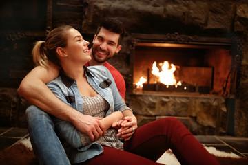 Happy hugging couple enjoying in mountain house
