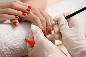 Poster de jardin Manicure Young woman getting professional manicure in beauty salon, closeup