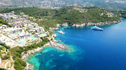 Fotobehang Eiland Aerial drone bird's eye view photo of famous village and port in bay of Sivota, Epirus, Greece