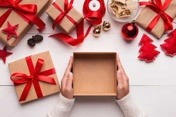 Woman hands holding empty Christmas gift box